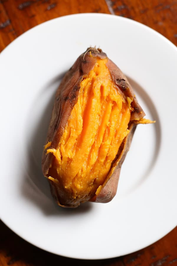 Cooked sweet potato on white plate.