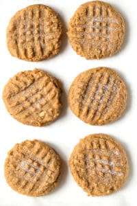 Six peanut butter cookies. The tops are sprinkled with granulated sugar.