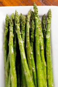 Roasted Asparagus on white platter.
