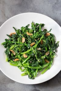 How to Cook Broccoli Rabe: Easy Recipe. Photo Shows Sauteed Broccoli Rabe with garlic and red pepper flakes.