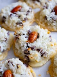 Baked coconut macaroon topped with an almond.
