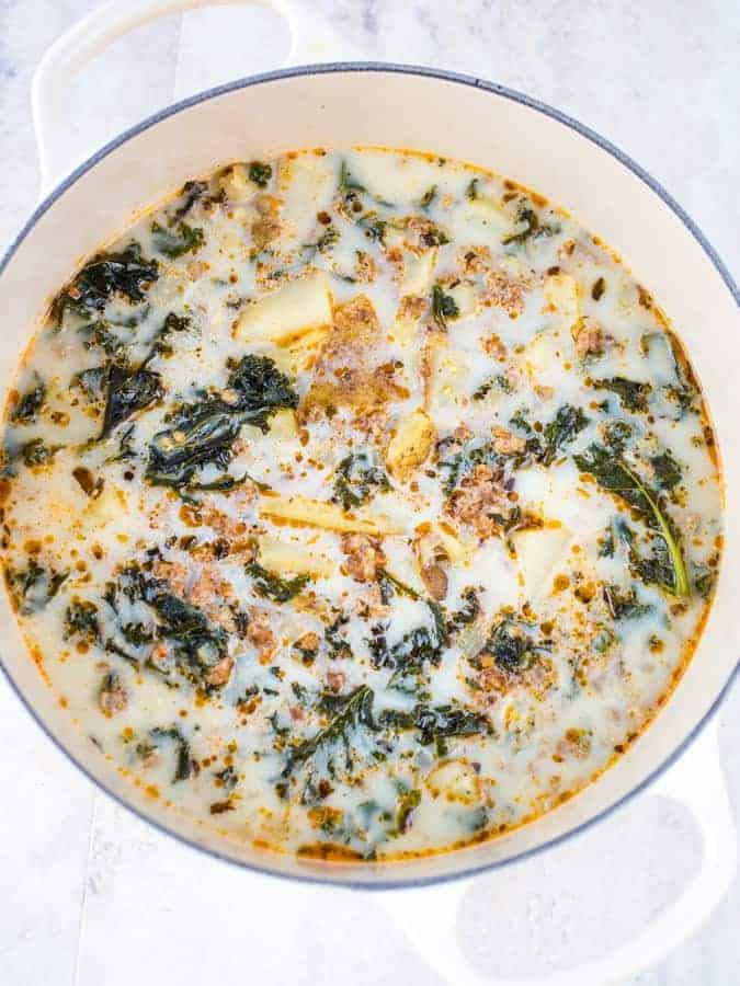 White pot of cooked zuppa toscana soup.