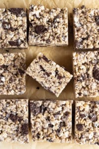 Cut Oreo Rice Crispy Treats on Brown Parchment.
