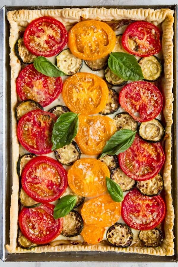 Baked Overhead Image of Tomato Slab Pie with Basil
