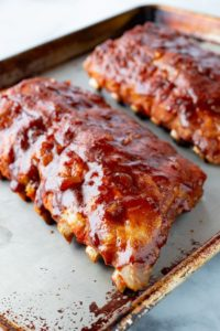 Cooked Instant Pot Ribs on a Sheet Pan. Brushed with BBQ sauce