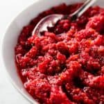 Cranberry relish in a bowl with a spoon
