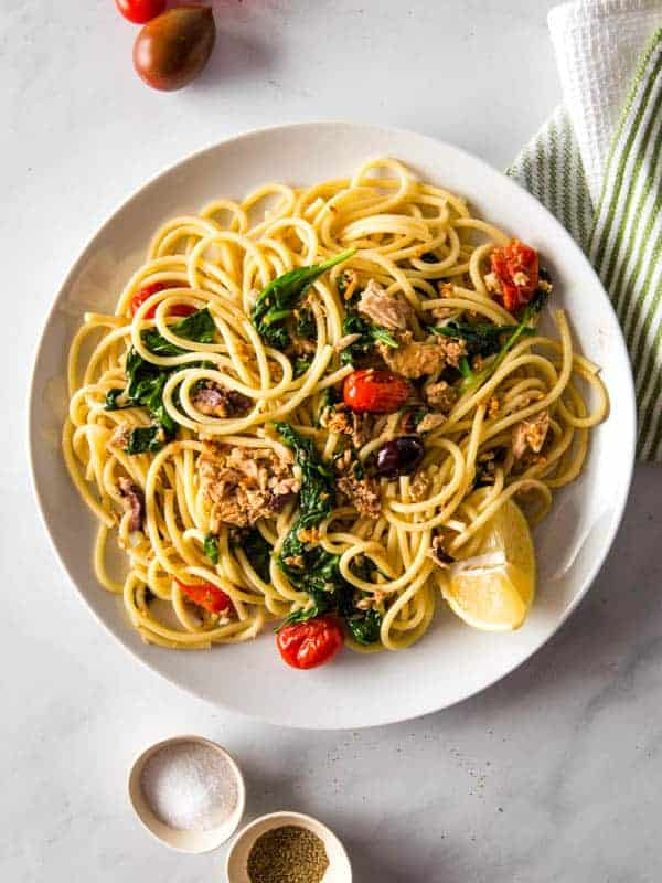 Bowl of Pasta with tuna, spinach, tomatoes, and lemon