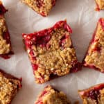 Baked cranberry oatmeal bar cut into squares.