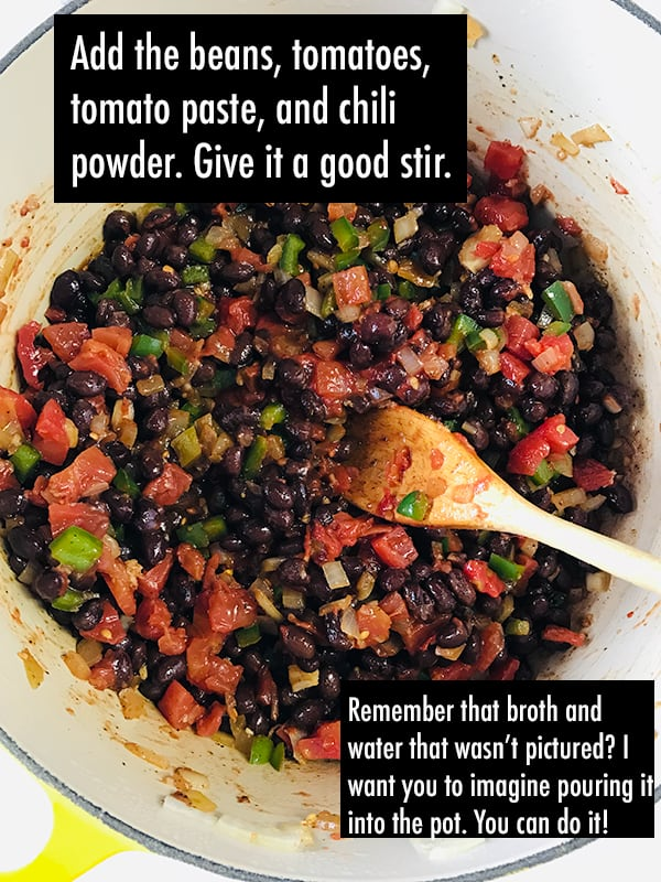 Tortilla soup ingredients in a pot. Text on image: Add the beans, tomatoes, tomato paste, and chili powder. Stir.