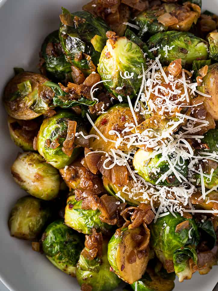 Cooked Brussels Sprouts topped with shredded parmesan
