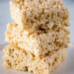 Three rice krispie treats stacked on a plate.