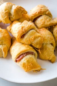 Ham and cheese crescent rolls on a plate.