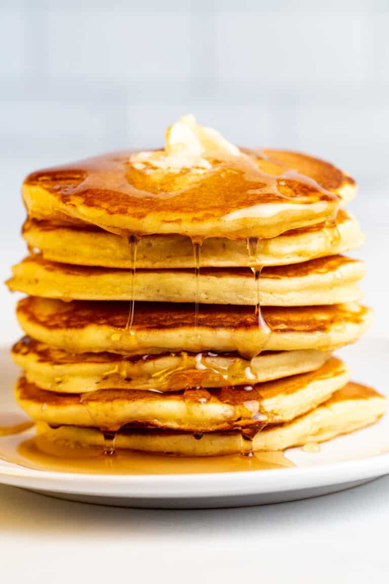 A Stack of Pancakes on a Plate with Syrup